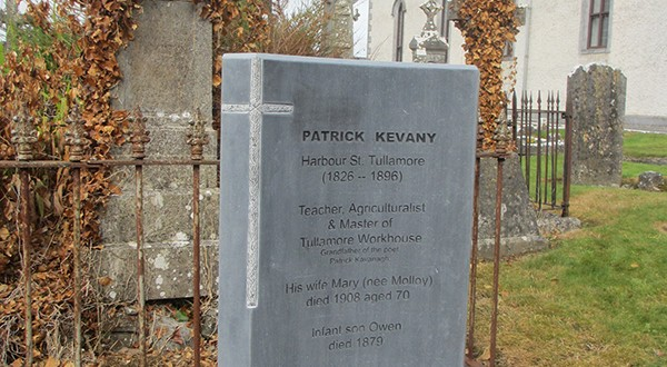 Gravestone-with-St-Colmcille's-RC-church-in-background-