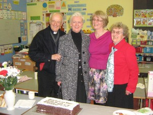 Photo of Fr. Peter taken at the retirement of Nuala Dinsmore as Vice Principal Of Scoil Cholmchille, Blackstaff.